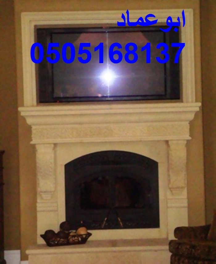 Cast-stone-fireplace-with-tv